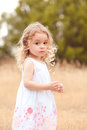 Little baby girl walking in meadow