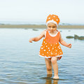 Little baby girl walking on the water Royalty Free Stock Photo