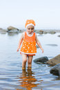 Little baby girl walking on the water Stock Image