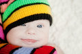 Little baby in hat gnome with downs syndrome girl Stock Photography