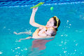 Little baby and her mother in swimming pool relaxing the Stock Photography