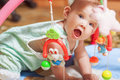 Little baby playing with toys at home Royalty Free Stock Image