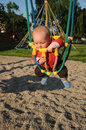 Little baby in rope swing Royalty Free Stock Photos