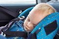 Little baby sleeping in a car seat Royalty Free Stock Image