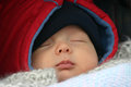 Little baby sleeping outside in his stroller on a winter day Royalty Free Stock Photo