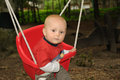 Little baby on swing Stock Photos