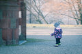 Little baby toddler exploring cold outside world curiously outdoors in winter Stock Images