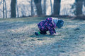 Little baby toddler fall down during exploring outside world fell on knees outdoors Royalty Free Stock Photo