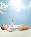 Little baby under the sun and the sky blue Stock Photo