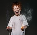 Little bad boy redhead with sparkling wires Royalty Free Stock Photos