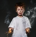 Little bad boy redhead with sparkling wires Stock Image