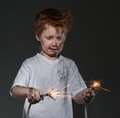 Little bad boy redhead with sparkling wires Stock Photo