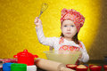 Little baker or cook girl cuts dough for cookies Royalty Free Stock Photo