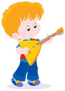 Little balalaika player boy playing a russian Stock Images