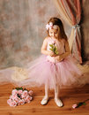 Little ballerina beauty holding a pink rose Stock Images