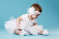 Little ballerina on blue background cute Stock Photos