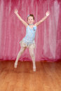 Little ballerina jumping in blue tutu on a stage Stock Image