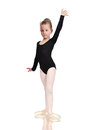 Little ballerina in pointe standing on floor Royalty Free Stock Images
