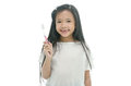 Little beautiful asian girl brushing teeth missing Royalty Free Stock Images