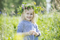 Little beautiful baby girl outdoors in a field in the fresh air Royalty Free Stock Photo