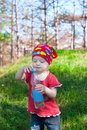 Little beautiful girl in bright clothes holding a water bottle hand Royalty Free Stock Photography