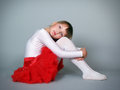 The little beautiful girl the dancer sits in studio Royalty Free Stock Photo