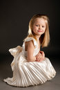 Little beautiful girl on dark background Royalty Free Stock Images