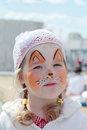 Little beautiful girl with face painting of orange fox Royalty Free Stock Photo