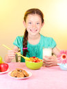 Little beautiful girl have a breakfast Stock Photos