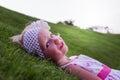 Little beautiful girl lies on the green grass selective focus Stock Photo
