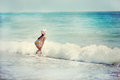 Little beautiful girl playing in the waves Royalty Free Stock Images