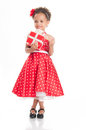 Little beautiful mulatto girl with gifts happiness Stock Photos