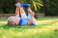 Little beautiful pretty happy girl lying on the grass Royalty Free Stock Photo