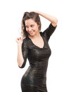 Little black dress portrait of festive gorgeous young brunette in tight sequin Royalty Free Stock Photos