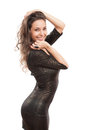 Little black dress portrait of festive gorgeous young brunette in tight sequin Royalty Free Stock Image