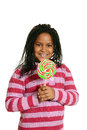 Little black girl with big lollipop isolated Royalty Free Stock Image