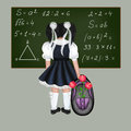 Little black haired schoolgirl with a big backpack and flowers drawing back to school Stock Image