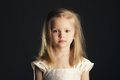 Little blond beautiful girl with long hair Stock Photography