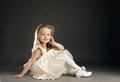 Little blond beautiful girl with long hair Stock Photos