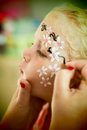 Little blond blue eyed girl face painting Royalty Free Stock Photo
