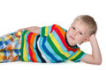 Little blond boy rests a is resting on the white background Stock Image