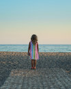 Little blond girl looking at the sea Royalty Free Stock Photo