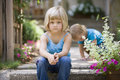 Little blond girl sitting on steps Royalty Free Stock Photo