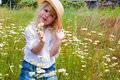 Little blond girl in wild daisies caucasian holding wildflower Royalty Free Stock Photo