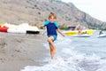 Little blond kid boy running ocean beach Royalty Free Stock Photo