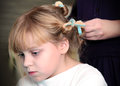 Little blond Russian girl with curlers Stock Photo