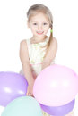 Little blonde girl with balloons in studio Stock Image