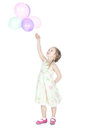 Little blonde girl with balloons in studio Royalty Free Stock Photos