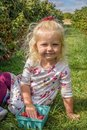 Little blonde girl at a berry farm Royalty Free Stock Photo