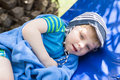 Little blonde toddler boy in swimm suit on couch outdoors Royalty Free Stock Images